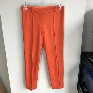 Trina Turk orange front seam skinny pants size 4